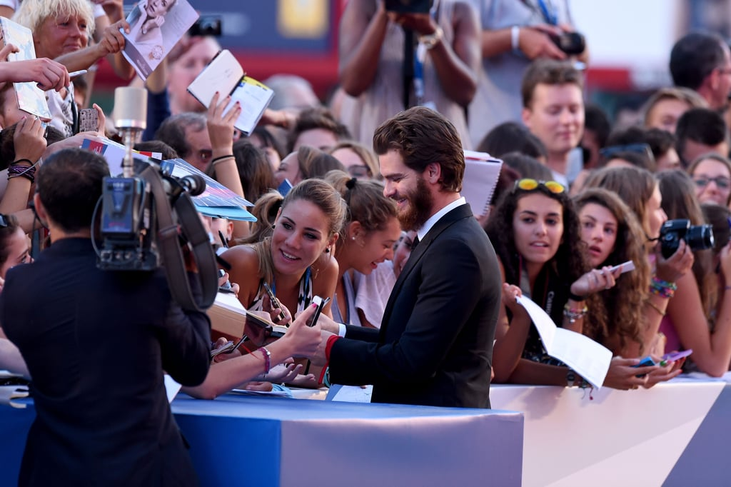 Andrew Garfield signed autographs for waiting fans at the premiere of 99 Homes.