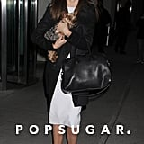 Miranda Kerr wore a white dress and black coat while out in NYC.