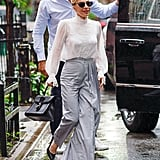 Lady Gaga's high-waist pants are statement-making, and the perfect counter to her romantic top.