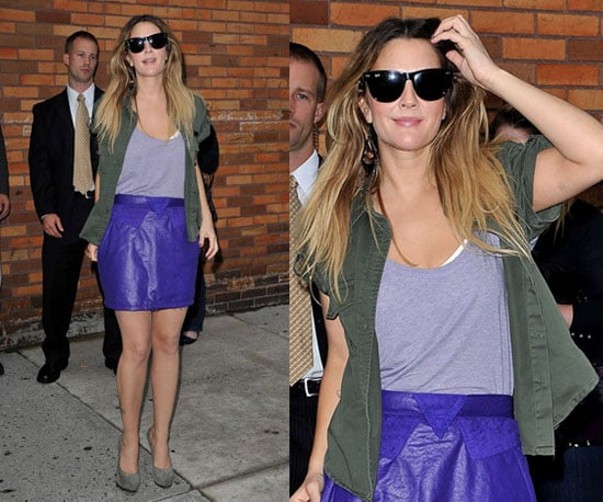 Drew Barrymore at The Daily Show in NYC Wearing a Purple Leather Skirt