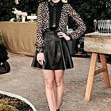 Jaime King celebrated ShoeMint's one-year anniversary in a leather skater skirt and printed blouse by Jason Wu.