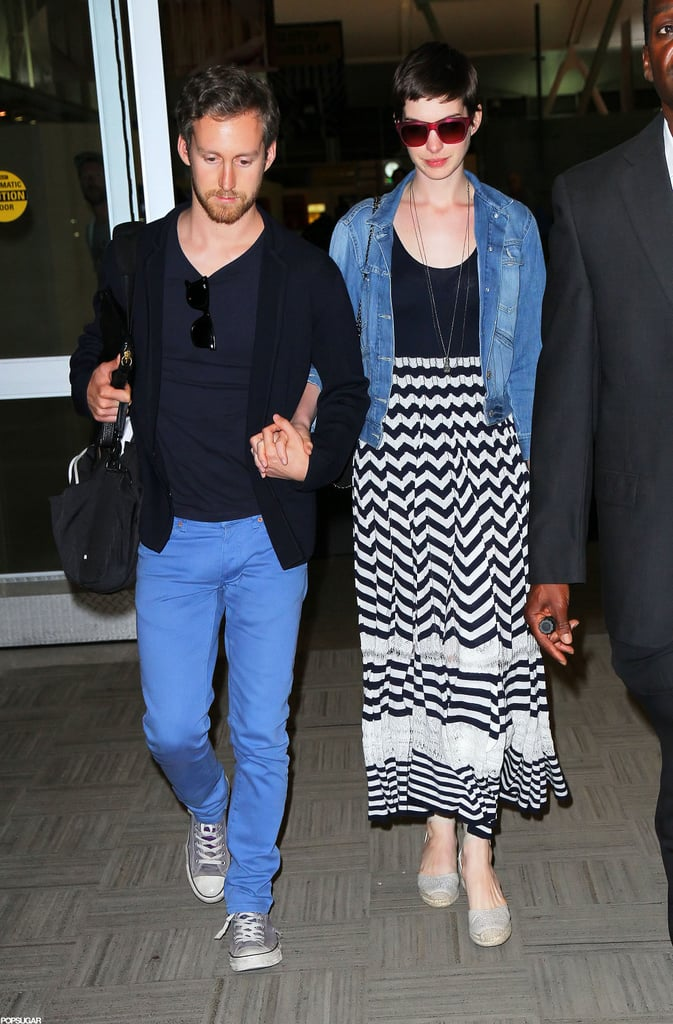 Anne Hathaway and Adam Shulman went through security together at LAX yesterday, and later on touched down at JFK airport in NYC. They were home in the Big Apple after an extended stay in LA around the release of Anne's blockbuster, The Dark Knight Rises. The movie's debut was of course marred by the horrific Colorado shooting, but Dark Knight has done well at the box office thanks to devoted and undeterred Batman fans. Now, Anne and Adam have another exciting event to plan for with an upcoming wedding. They've been mum about details, but did host an engagement party at Manhattan's Housing Works Bookstore Café in February.