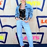 Combining masculine and feminine, Hailey Baldwin wore a vintage Dior corset, a Levi's denim trucker jacket and jeans, a Jack Vartanian chain, her signature Bieber necklace, and red, high-top Vans to the Levi's party. When re-creating this look, don't be afraid to go oversize with your denim and pile on the jewelry.