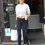 While out running errands in Los Angeles, Chrissy wore a sporty ensemble that included a cropped sweatshirt, tight leggings, and Nike sneakers.