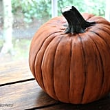 Voilá! You would never know this pumpkin is plastic. Check out more great stories from Jennifer Decorates:  Make a Fall Pumpkin Topiary Create a Spooky One-of-a-Kind Light Create a Ghostly Table For Your Guests