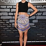 Shailene Woodley balanced a colorful printed skirt with a black crop top, both by Emilio Pucci, and matching Casadei pumps.