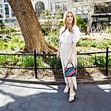 Midi skirts are my absolute favorite, so I revisited the combo, this time opting for a wrap silhouette. I'm also partial to tonal neutrals, so I went with a natural oat shade in linen and added in ivory, block-heel sandals. For a fun twist, I reached for a rainbow-stripe bag to liven up my otherwise muted palette.  On Laura: POPSUGAR at Kohl's puff-sleeve button-down top, OZMA skirt, Charles & Keith sandals, Michino Paris bag.