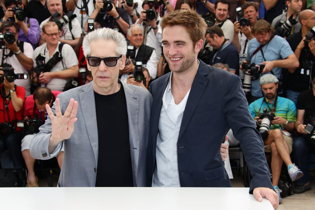 Robert Pattinson posed with David Cronenberg at the Cosmopolis photocall in Cannes.