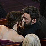 Ben and Jennifer stole a kiss in their seats during the Oscars in February 2013.