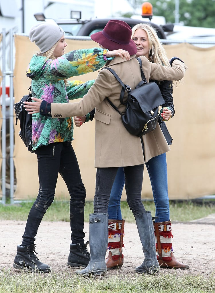 Poppy and Cara Delevingne greeted Alexa Chung with a group hug.