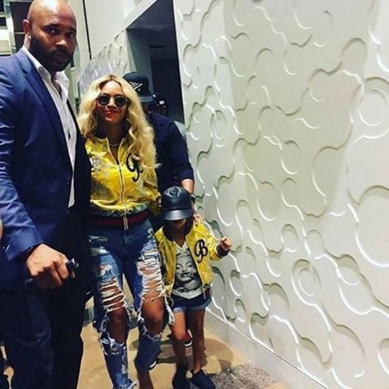 Beyoncé and Blue in matching monogrammed Gucci bombers at Dallas Cowboys football game with Jay Z and Tina Knowles