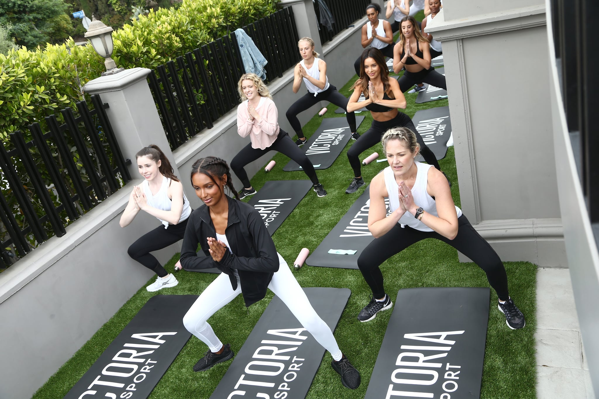 LOS ANGELES, CA - MAY 24:  Jasmine Tookes (C) and guests attend Victorias Secret and Tone It Up Host a Slay Then Rosé workout with Angel Jasmine Tookes on May 24, 2018 in Los Angeles, California.  (Photo by Tommaso Boddi/Getty Images for Victoria's Secret)