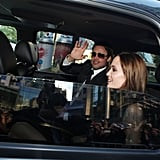 Brad Pitt and Angelina Jolie waved to fans upon their arrival at his September 2011 TIFF Moneyball premiere.