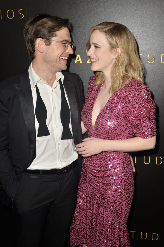 """Rachel Brosnahan has quickly become one of TV's biggest breakout stars. Though this certainly isn't her first brush with fame, she's gained critical acclaim for her role on The Marvelous Mrs. Maisel. While she's very reserved about her personal life, specifically her love life, we do know one thing for sure: she's happily taken.  If you watch Syfy's The Magicians or TV Land's Younger, then you probably already know her husband, Jason Ralph. The two first met in 2015 while working on the WGN series Manhattan and have been together ever since. While the two have kept pretty mum about the state of their relationship, Rachel confirmed to People that they are indeed married. """"We've been married for years and been together for even longer,"""" she said during the 2019 SAG Awards. """"We had a good laugh when the news came out that we had just got married, like 'Happy six-month anniversary, honey!'"""" While the couple keep their relationship private, they certainly aren't shy about showing off their love on the red carpet. Jason has even accompanied Rachel to various award shows. As we will undoubtedly be seeing more of the actress in the future, see some of her sweetest moments with Jason ahead."""