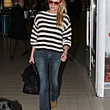 Diane Kruger looked comfortable in jeans while she walked through the airport.