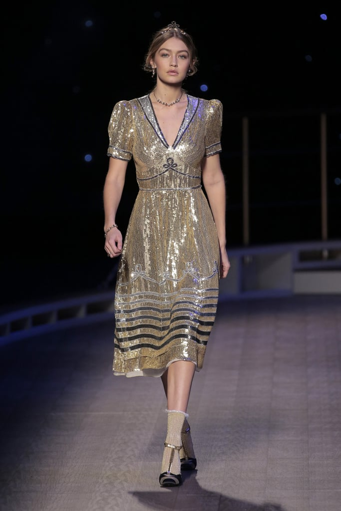 9efe8bf5bf1 Gigi closed the Tommy Hilfiger show in a sequined gold lamé sailor dress,  metallic T