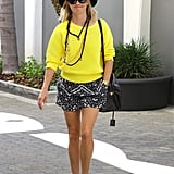 We love how Reese brightened her moody separates with a sunny knit and a few dazzling necklaces.