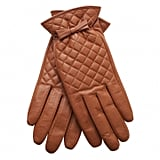 Everyone needs a lovely pair of leather gloves, and these Oliver Bonas quilted bow leather gloves (£18) are just perfect.