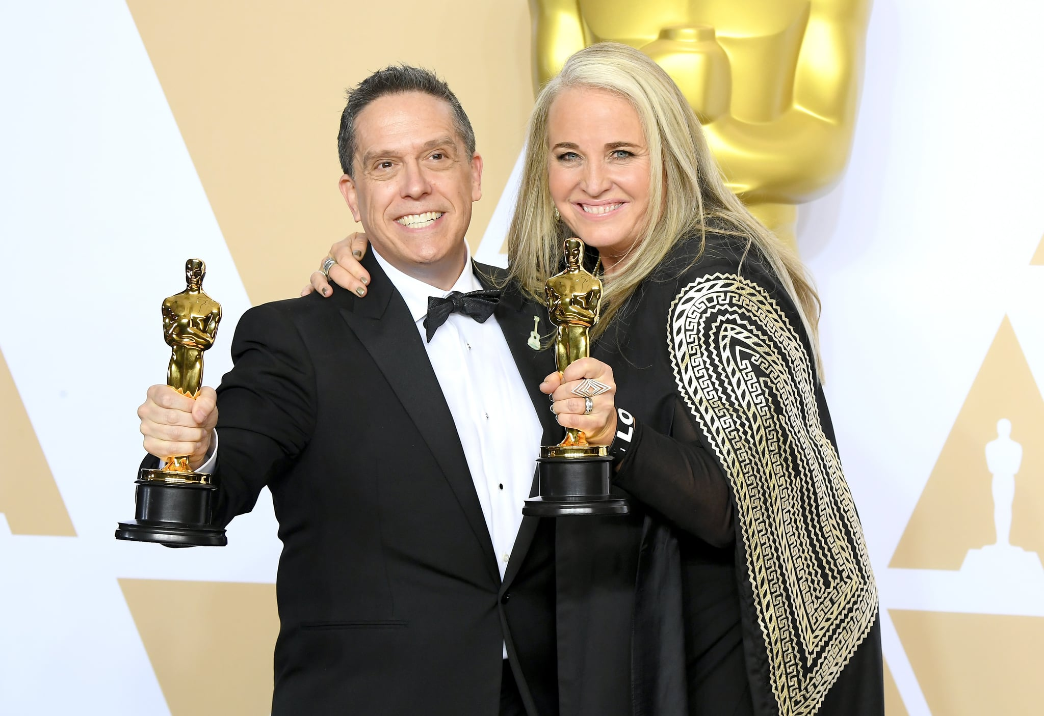 "HOLLYWOOD, CA - MARCH 04:  Director Lee Unkrich (L) and Producer Darla K. Anderson, winners of the Animated Feature award for ""Coco"" pose in the press room during the 90th Annual Academy Awards at Hollywood & Highland Center on March 4, 2018 in Hollywood, California.  (Photo by Steve Granitz/WireImage)"