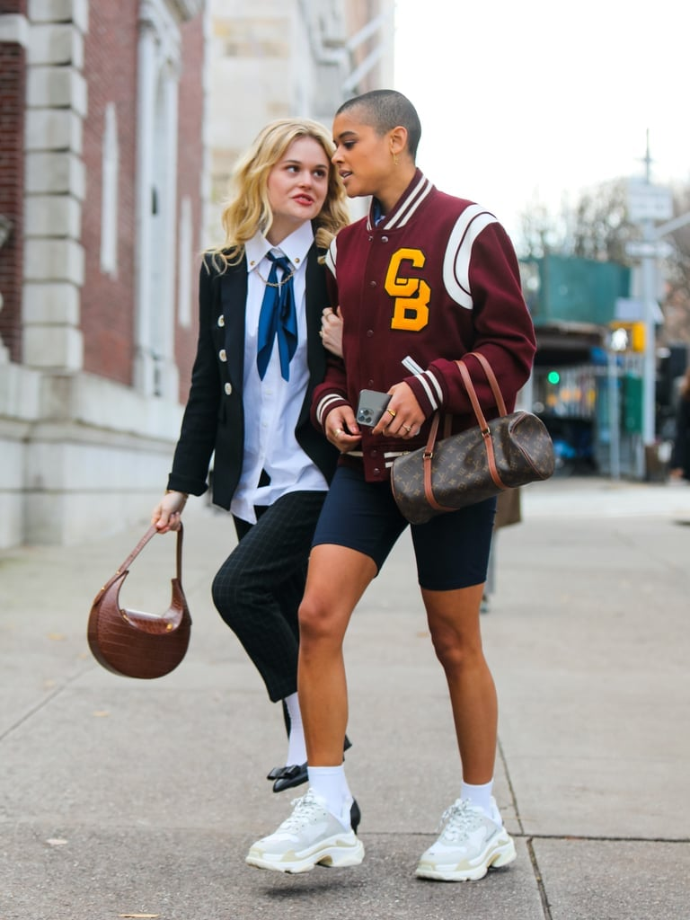 """Aside from the new iterations of the uniforms, you'll also notice that the accessories like handbags play a significant role in the characters' wardrobes, just like on the original series. """"With the bags, I chose a lot of secondhand, thrift, and resale pieces since there's a movement towards sustainability. Sustainability is a huge part of how Gen Z is shopping and giving these luxury bags a second life. This generation identifies with these heritage brands differently because of this and the fact that the quality of these bags has a much longer shelf life than disposable fashion.""""  Of course, that didn't stop the reboot from including bags right off the runway, as you can tell from the first episode. """"It was important to have still the giant LV bag moment,"""" Eric revealed. """"I think it's sensational, fun, and part of the GG fantasy. But Serena [from the original series] was definitely not carrying a secondhand bag."""""""