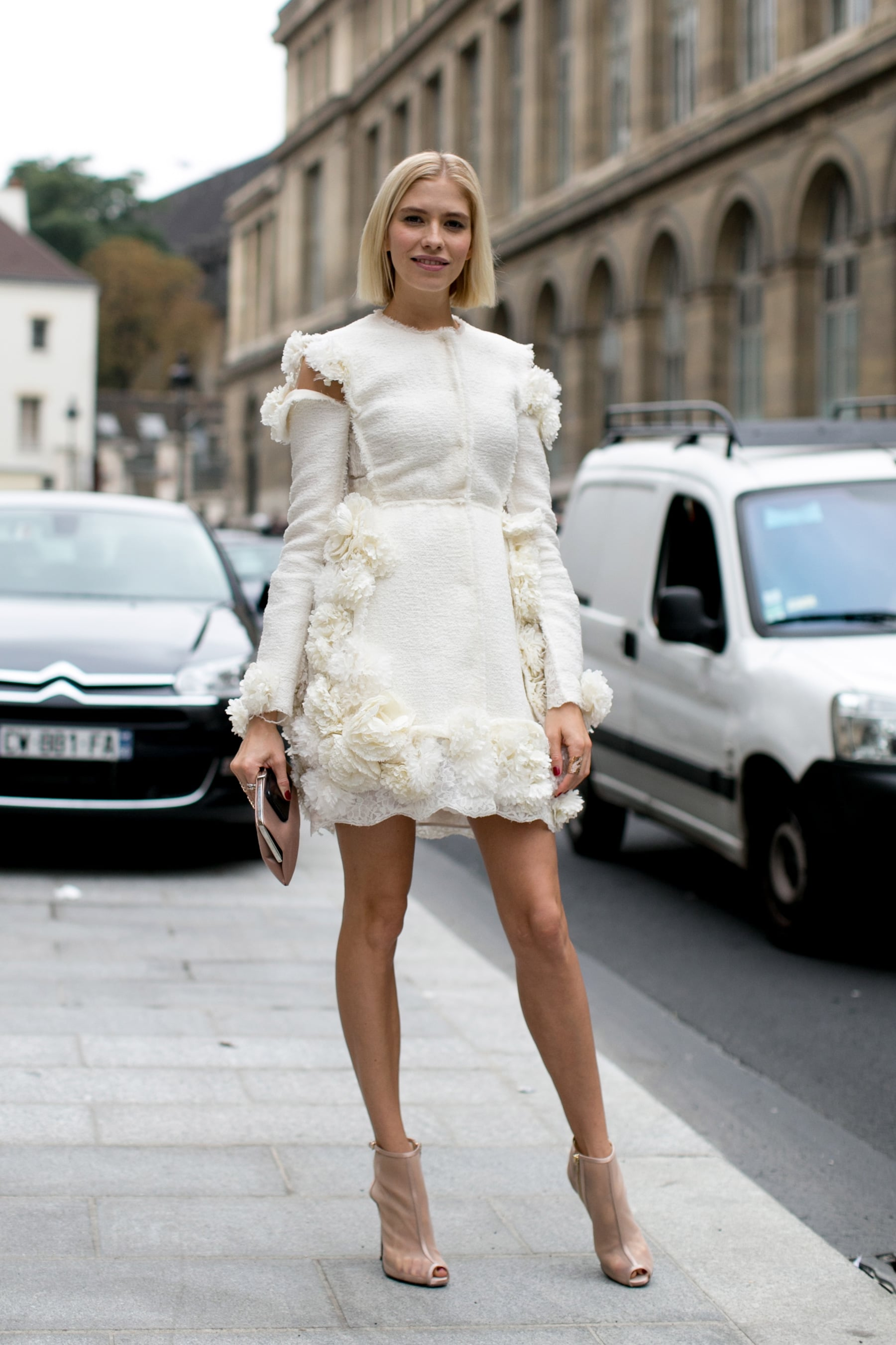 Elena Perminova brought a bit of girlie drama in a frothy white dress.