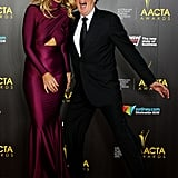 Delta Goodrem had a laugh with Geoffrey Rush on the AACTA Awards red carpet.