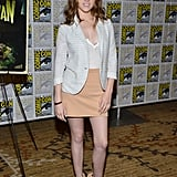 Anna Kendrick complemented a peachy-hued skirt with a sleek white blazer and nude heels.