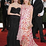 Jessica Chastain showed off Drew Barrymore's baby bump on the 2014 Golden Globes red carpet.