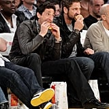 Adrien Brody and Gerard Butler chowed down on burgers while watching a Lakers game together in March 2010.