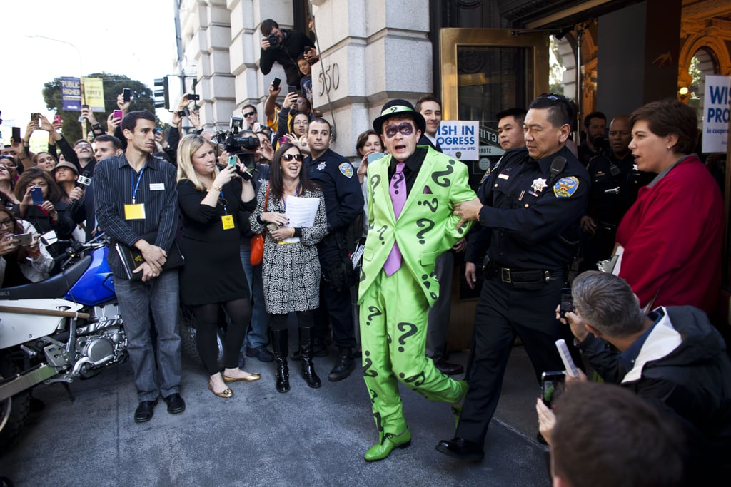 The crowd snapped pictures after the Riddler was arrested.