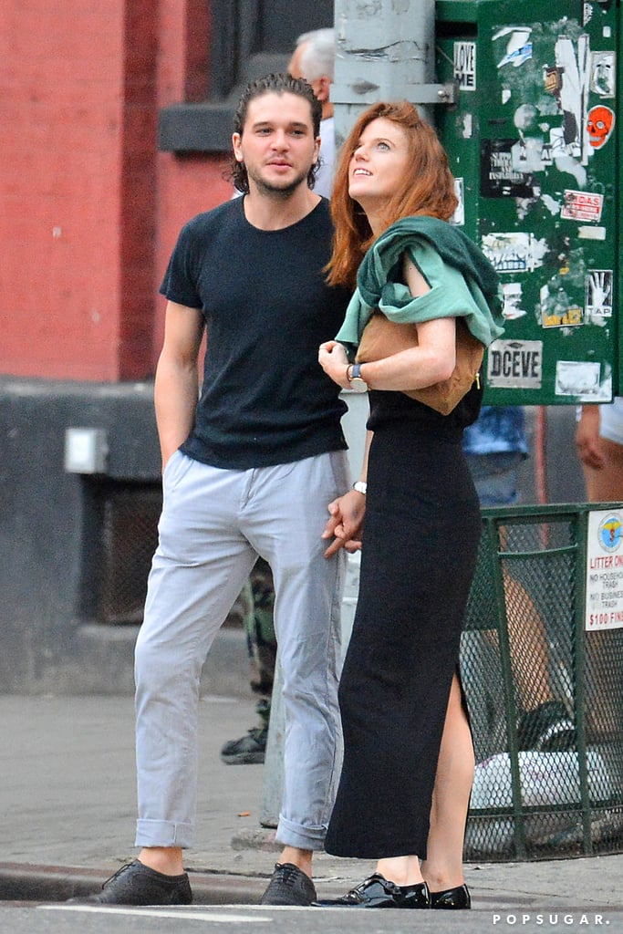 """Kit Harington and Rose Leslie enjoyed a sunny stroll around NYC on Thursday afternoon. The couple, who first met on the set of Game of Thrones, walked hand in hand and shared a few sweet laughs together as they made their way through the busy city. Kit and Rose began dating in 2012, but shortly after, the duo called it quits. Luckily, they rekindled their romance in 2014 and have been going strong ever since. Earlier this year, Kit revealed his best memory from the show was spending three weeks filming in Iceland for season two """"because the country is beautiful, because the Northern Lights are magical, and because it was there that I fell in love.""""       Related:                                                                17 Things You May Not Know About Kit Harington                                                                   Breakup to Makeup: 38 On-Again, Off-Again Celebrity Couples"""