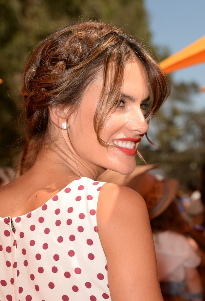 Alessandra Ambrosio shows off the perfect pairing for a red lip: a piecey milkmaid braid.