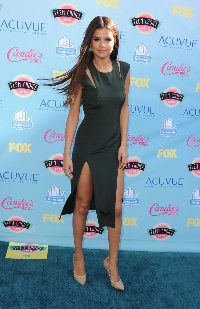 """Selena Gomez made her legs the star of the Teen Choice Awards blue carpet today when she made an appearance in a green Cushnie et Ochs dress with a daring double slit. The singer-slash-actress was up for several awards tonight, including choice female artist and choice single: female artist for """"Come & Get It."""" She won choice female hottie, choice music star: female, and choice breakup song for """"Come & Get It."""""""
