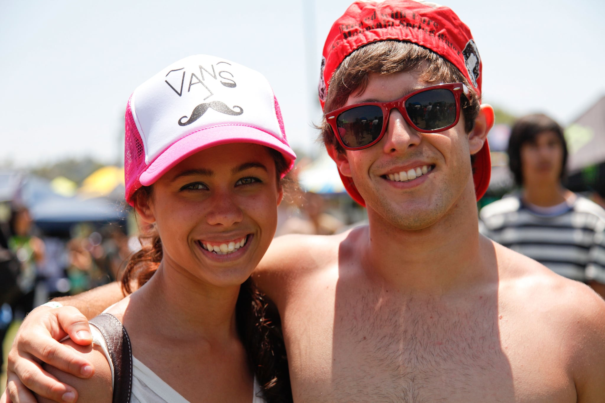 A cute couple donned hats at the 2012 Vans Warped Tour at Pomona Fairplex in Pomona, CA.