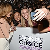 Naya Rivera leaned in to pose with a few fans.