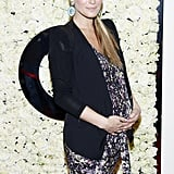 Pregnant Molly Sims hit the red carpet at a QVC party.