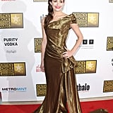 Emmy Rossum opted for a gilded and draped Donna Karan gown that conjured up images of a Grecian goddess.