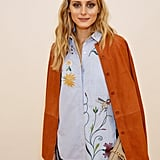Olivia wore this Tibi suede shirt over her Zara-embroidered top, proving the burnt brown hue does go with everything.