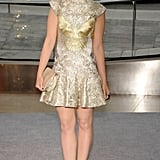 Lily Collins, the presenter of the night's Swarovski Award, wore a gold jacquard minidress and Atelier Swarovski jewels.