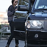 Mila Kunis got into the car with Ashton Kutcher on the way to the movie theater in LA.