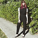 A Jumpsuit With a T-Shirt Underneath and Heels