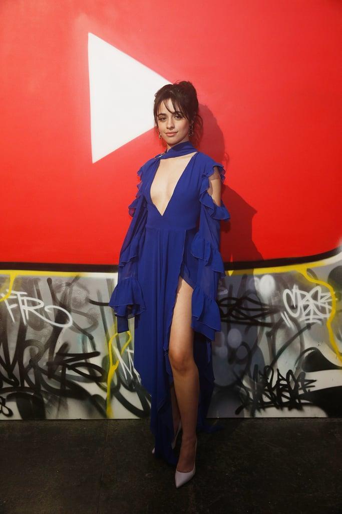 Camila Cabello in an Off-White neck-tie dress.
