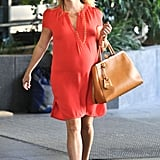Reese Witherspoon carried a tan tote.