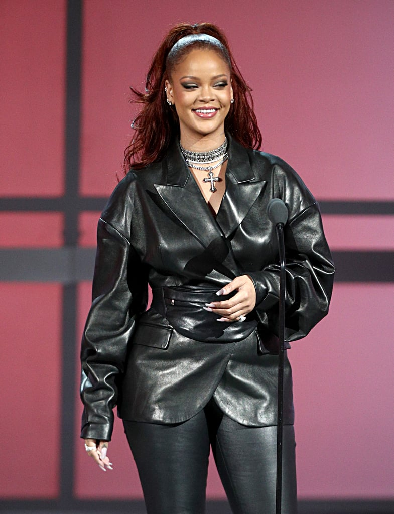 "After three long years, Rihanna made a surprise appearance at the BET Awards on Sunday. The 31-year-old singer — and world's richest female musician — somehow managed to skip the red carpet and make her way inside undetected; however, cameras finally spotted her when she was cheering on Lizzo during her energetic ""Truth Hurts"" performance. Even though Rihanna's appearance was unannounced, she was on hand to present Mary J. Blige with the lifetime achievement award. During her speech, Rihanna — who stunned in a figure-hugging leather outfit — praised Mary for ""forever aligning the worlds of hip-hop and R&B"" and ""changing the game with her unique sound."" She also linked up with Regina Hall, Wale, and Billy Ray Cyrus after he took the stage for ""Old Town Road"" with Lil Nas X. Yep, Rihanna at the BET Awards is a whole mood!       Related:                                                                                                           LOL! Rihanna Goes Day Drinking With Seth Meyers, and of Course, They Get ""Sh*t-Faced"""