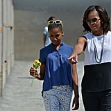 First Lady Michelle Obama visited the Berlin Wall in June 2013 with her daughters, Sasha and Malia.