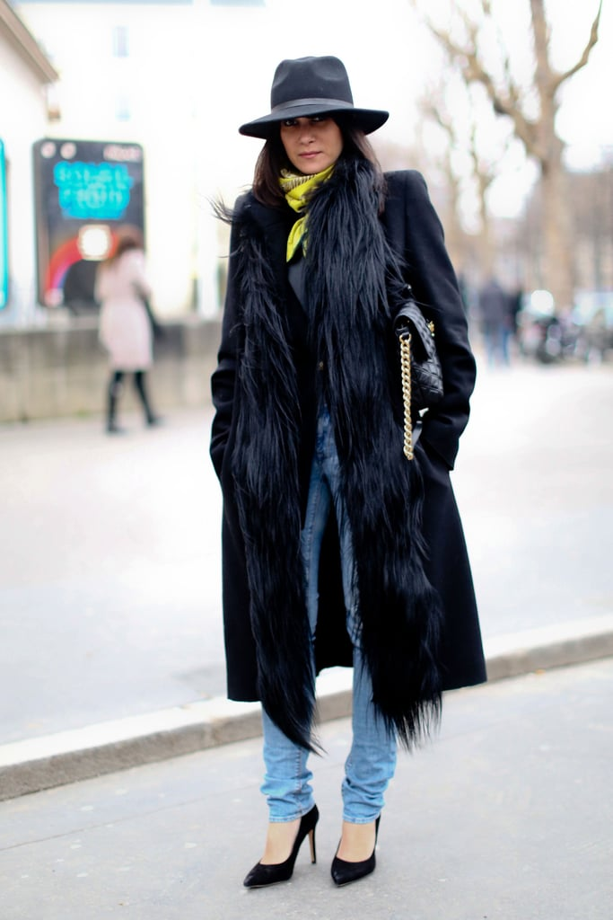 Layered up in fur and finished with sleek pumps and a fedora.