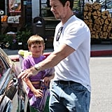 Mark Wahlberg helped his son into the car on Monday at Bristol Farms.