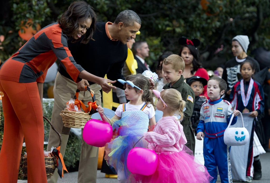 The president and first lady personally handed out candy at the White House on Thursday.