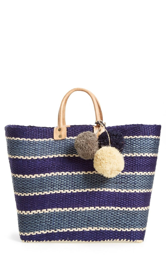 A great carryall tote that packs a punch with sweet pom-poms.  Mar y Sol Capri Woven Tote with Pom Charms ($135)