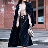 With a Pretty Lace Top, a Long Velvet Coat, and Feminine Heels